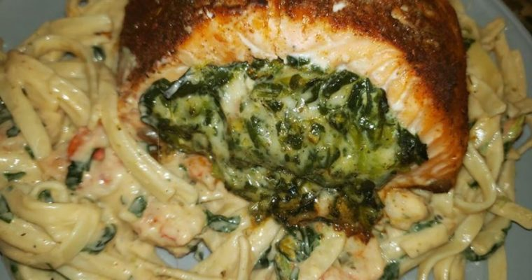 Blackened Salmon stuffed with spinach and parmesan cheese with shrimp and spinach alfredo